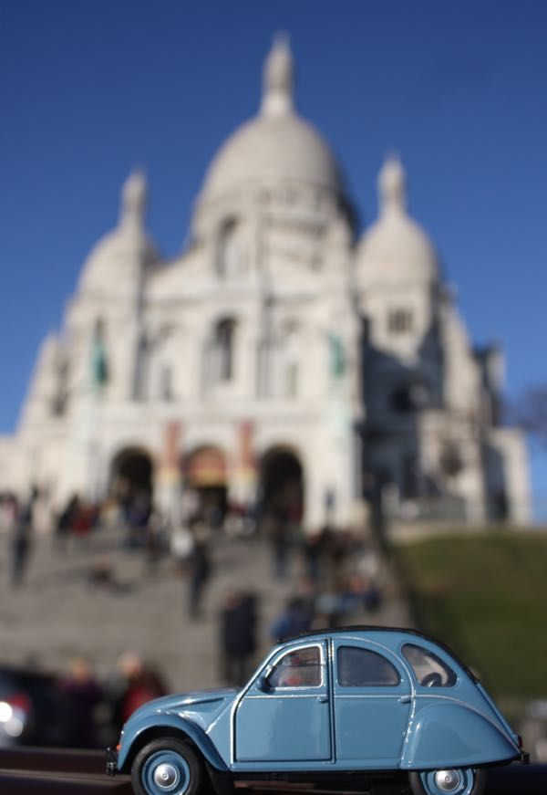 "2CV Week #6  PARIS PHOTO CHALLENGE: Think you know Paris? Each week I will be posting a picture of my Citroen 2CV car in front of a famous Parisian monument or location. Follow the challenge using the hashtag #JansFrance2CV on Twitter or Instagram or check out my website and make your guess. At the end of each week I will post the answer on my website under ""Paris"""