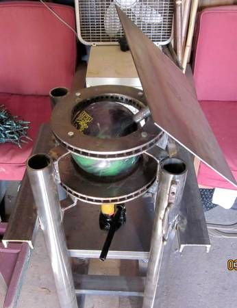 Homemade welding positioner table using bowling ball and brake rotors, jack