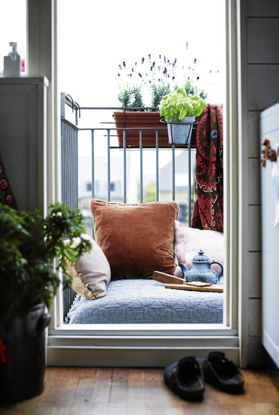 great idea for a small balcony. Especially if you don't have enough room for a chair. Lounge half in and out.