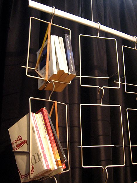 Hangers converted into hanging bookshelvesHanging Wire, Crafts Ideas, Wire Sculpture, Apt Ideas, Wire Bookcases, Hangers Bookshelves, Book Hangers, Hanging Bookshelf, Hanging Bookshelves
