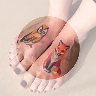 Yellow owl and orange fox watercolor foot tattoos by Sasha Unisex.