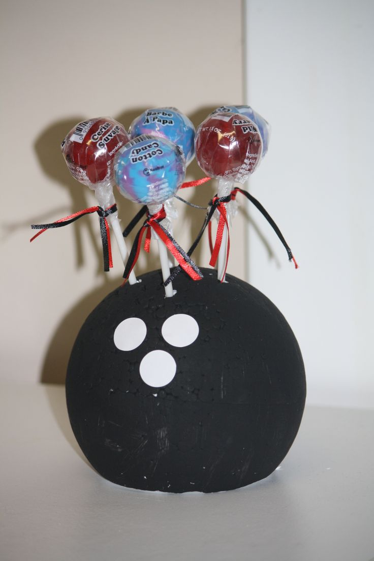 bowling table decor---styro foam ball painted black and lollipop