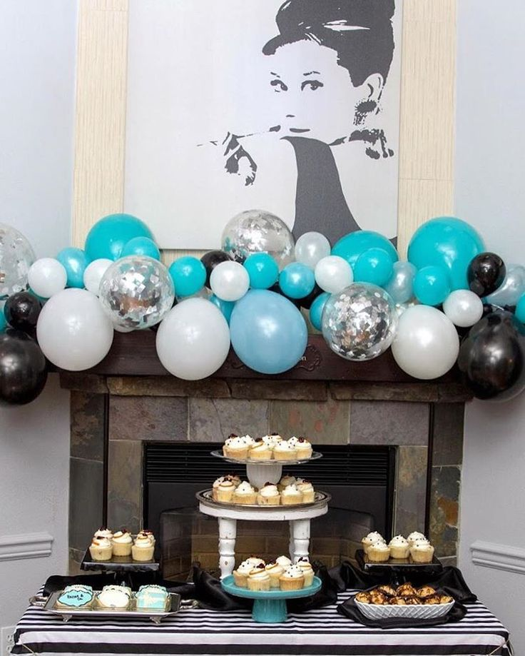 Breakfast at Tiffany's Balloon Garland Backdrop. Visit the One Stylish Party blog for ideas + inspiration on ways to style a balloon garland for your next celebration!