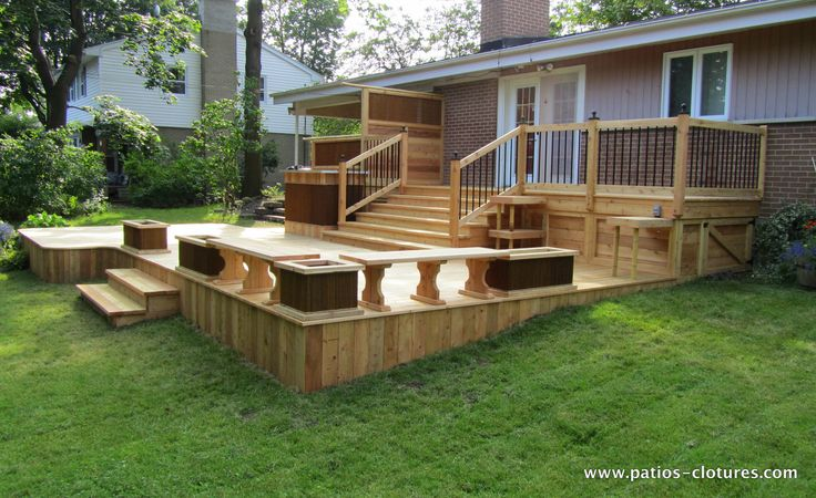Two-level red cedar deck with a bistro corner on the top level and a BBQ area, a bar, a dining area and a lounge on the lower level.