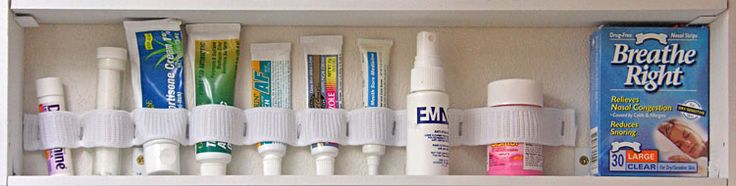 """This Rver solved her medicine cabinet problem using a strip of 1"""" wide elastic and staples."""