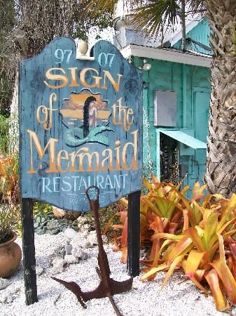 Sign of The Mermaid Quaint, unique, gulf side restaurant Breakfast, lunch, and dinner