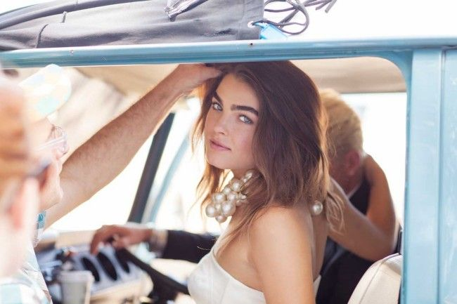Beach-side ride. Vogue Brides editorial with Bambi Northwood-Blyth and Dan Single.  Image: Nicole Cooper.