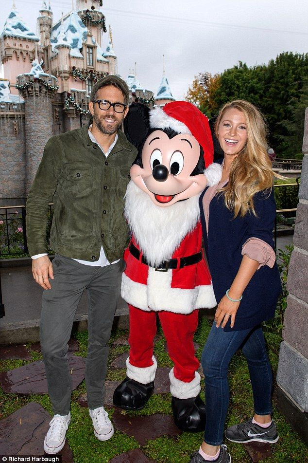 Ryan Reynolds and Blake Lively enjoyed a day out at Disneyland and stood for an adorable photo outside its iconic Sleeping Beauty's Winter Castle alongside a Father Christmas Mickey Mouse on December 16, 2016