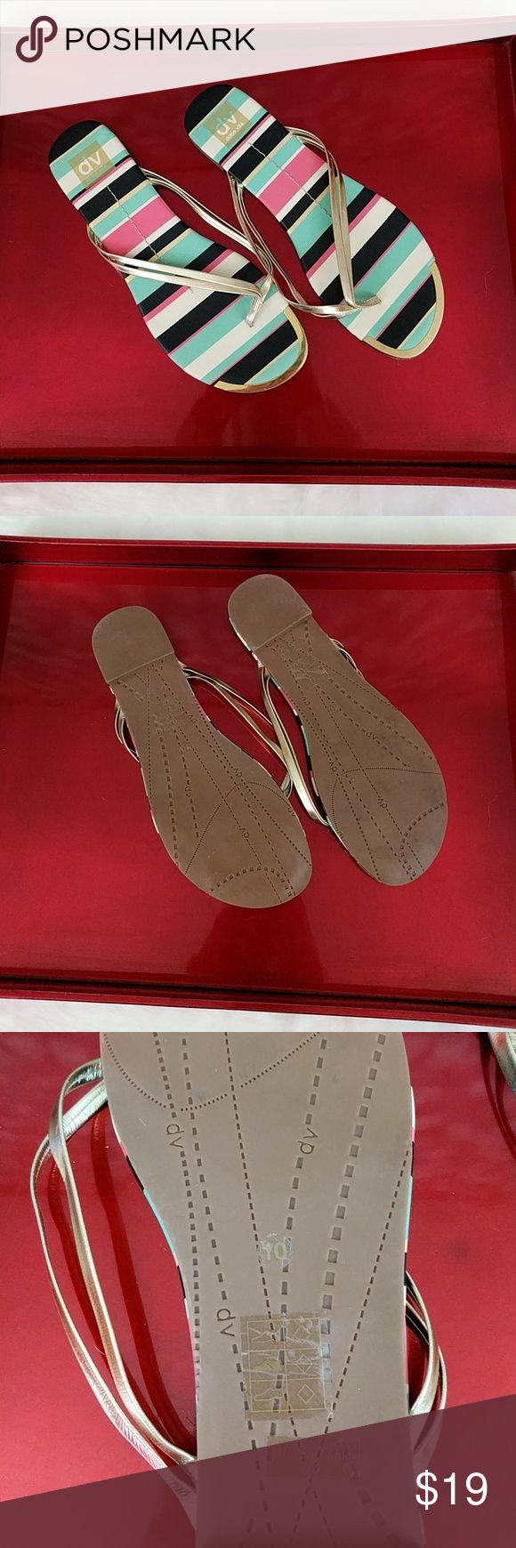 New! Dolce Vita Metallic Flip Flops New Dolce Vita flip flops with silvery straps and a gold toe accent plate. Right shoe does some discoloration on the bottom, but would not be noticeable while wearing. Dolce Vita Shoes Sandals
