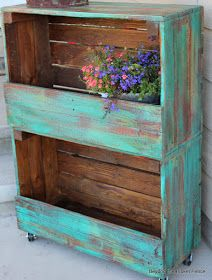 How To Create Stackable Storage using Crates - old crates were attached to each other, painted and stained to create movable storage. This post explains how.