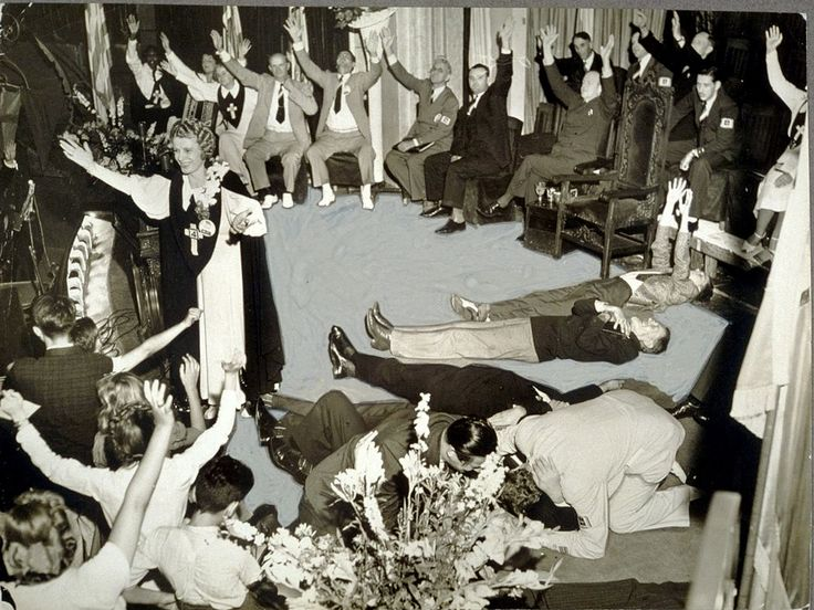 "Aimee Semple McPherson: founder of the Foursquare Denomination…and ""faith healer"" surrounded by her enraptured believers."