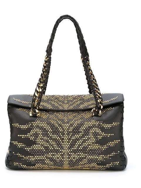 Shop Roberto Cavalli studded tote bag in D'Aniello from the world's best independent boutiques at farfetch.com. Shop 300 boutiques at one address.