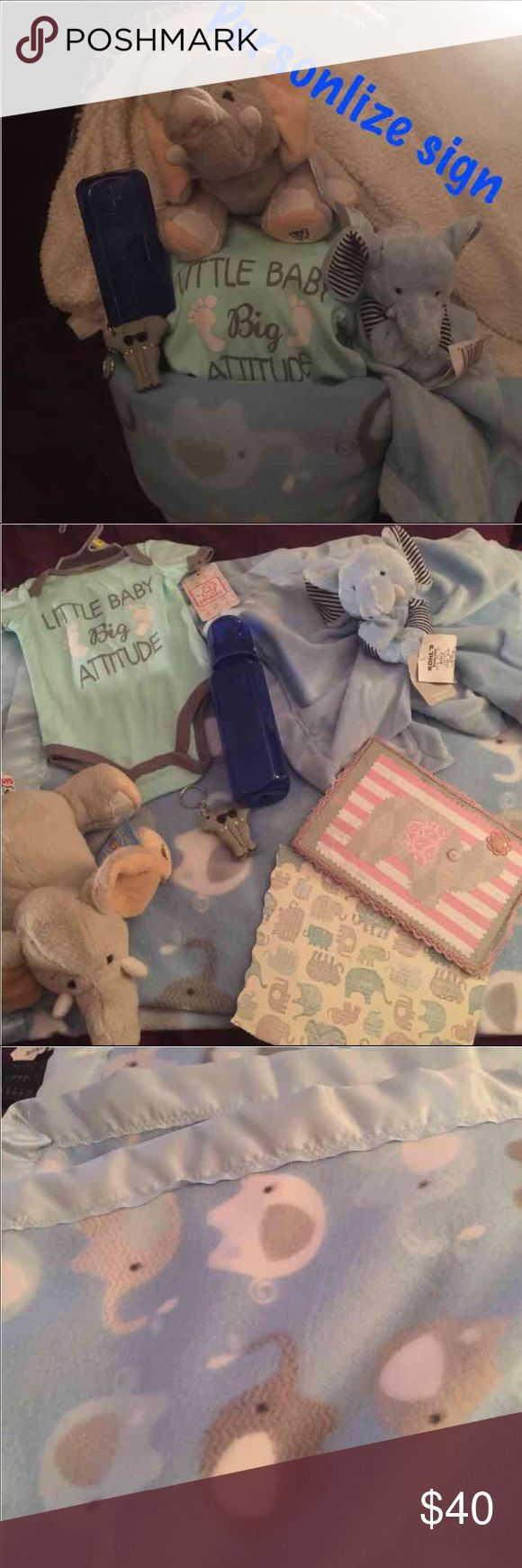 Boy elephant diaper cake 40x40 fleece elephant blanket with satin trim Little baby big attitude onesie  Webkinz stuff elephant  Elephant rattle blanket Bottle Elephant name clippers Personalize elephant sign ( have girl one there for example) Luvs or Huggie diaper wrap in plastic with ribbon Accessories