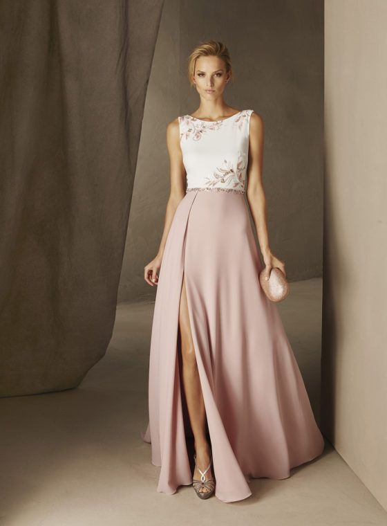 CAULA - Spectacular long dress with a springlike air. Its bateau neckline bodice and flared skirt look like two pieces. The nature-inspired gemstone embroidery on the bodice and spectacular georgette skirt with a deep front split make a statement.