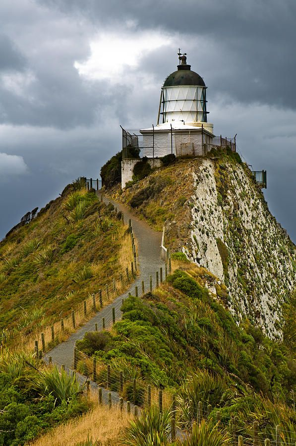 ✮ Nugget Point Light House an dark clouds in the sky, Catlins, New Zealand