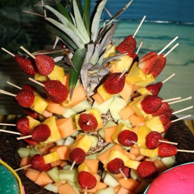 Another pinner said: Fruit kabobs stuck in a pineapple as a hula party centerpiece the kids loved it at my daughters hawaiian themed bday party