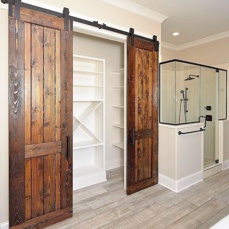We kinda have a thing for naturalwood finishes and this custom Cedar bi-parting door in this master bathroom by is no exception! & 398 best Sliding Barn Doors images on Pinterest | Sliding barn ... pezcame.com