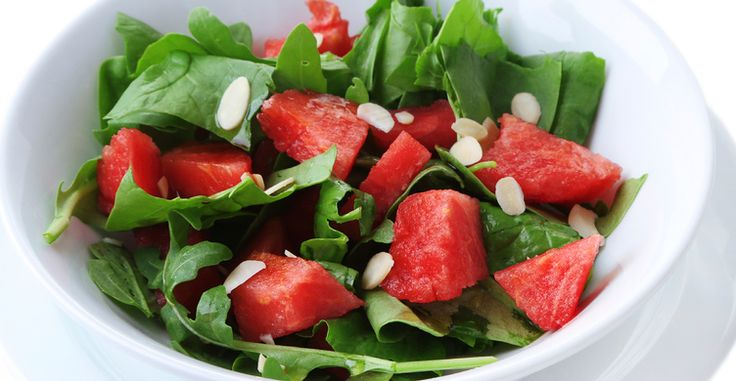 Top 1 cup raw spinach with 1 tablespoon balsamic vinegar and 3/4 cup diced watermelon - Delicious snack for under 100 calories!