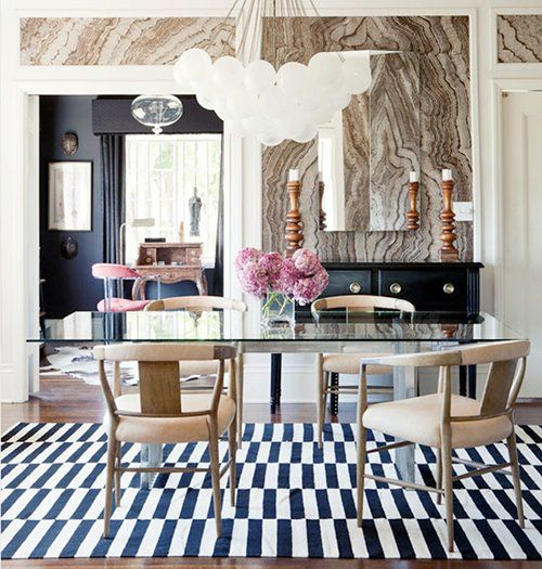 dream room has everything perfect: agate wall, offset-stripe rug, mid-century chairs, etc.
