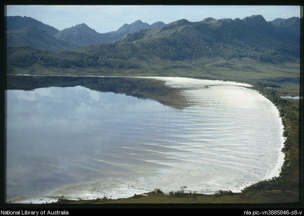 The characteristic sand waves in the shallows of Lake Pedder with a view to the plains around Maria Lake, Tasmania - Olegas Truchanas