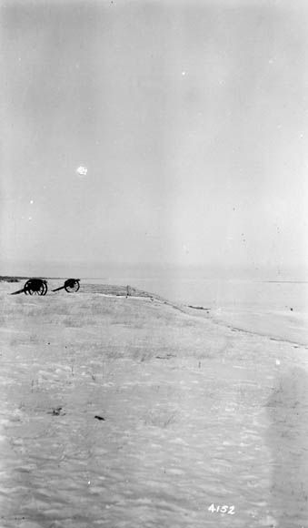 Two cannons, in front of York Factory, Hayes River, Hudson Bay in background, Manitoba, Canada. 1915.