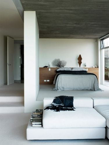 built in headboard/night stand with bed in front. Clean, simple http://whatwilsonwants.blogspot.com/2012/01/beach-house-beauty.html