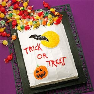 Trick-or-Treat Cake Recipe -This fun Halloween cake looks like a giant trick-or-treat bag with lots of sugary candy spilling out of it. I came up with the idea after reminiscing with my sisters about the times we went trick-or-treating together. —Amy McCoy, Huntington Beach, California