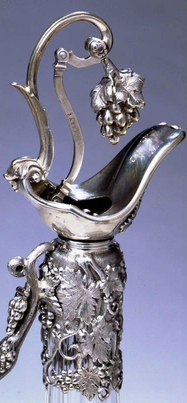 detail A Victorian silver mounted claret jug by Henry Wilkinson, Sheffield, 1854. This jug has a patent registration mark for the pouring mechanism and is contained in its original red leather case. Ht. 13""