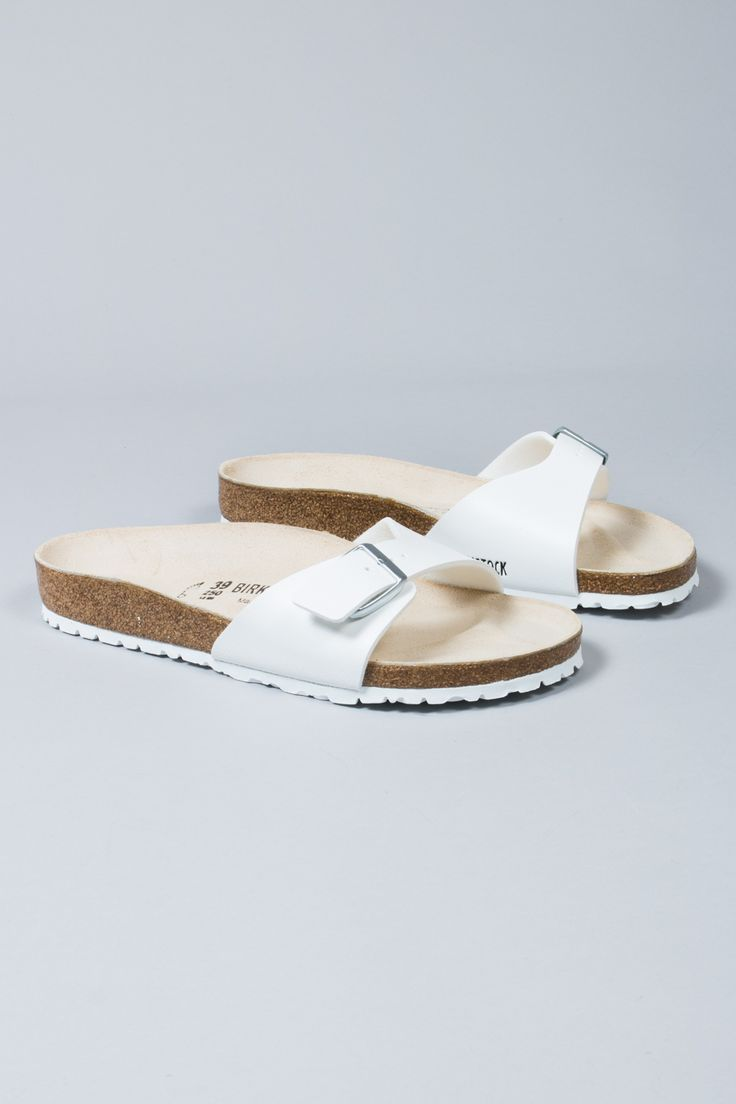 Birkenstock White Madrid One Strap Mule Sandals: When buying sandals, comfort is everything. Birkenstock have definitely understood that with this pair. They feature a single strap for an unrestrictive feel, white synthetic upper, shock absorbant latex sole and their trademark Eva footbed that allows our feet to move as they should!