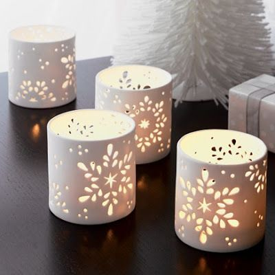.Snowflake candle holders - make with paper...with battery tea lights on bookshelf