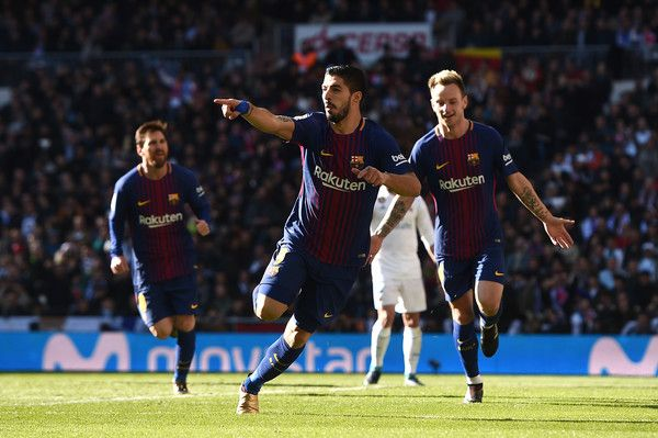 Luis Suarez of Barcelona celebrates after scoring his sides first goal during the La Liga match between Real Madrid and Barcelona at Estadio Santiago Bernabeu on December 23, 2017 in Madrid, Spain.
