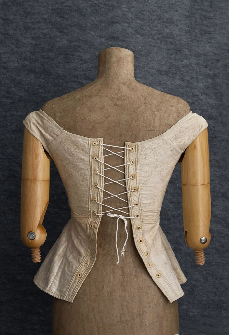 """Sold by VintageTextile #1688, c1820-40 Hand-embroidered wedding corset from ivory cotton, came from a Connecticut estate. Back closure has ivory eyelets. The center-front has a pocket for a busk. It measures: 31"""" bust, 20"""" waist, 31"""" hip, and 18 1/2"""" from shoulder to hem."""