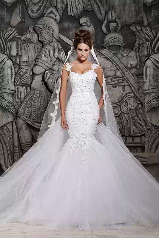 So sexy and elegant!  Lace mermaid wedding dress by RoyalWeddingStore, $1000.00