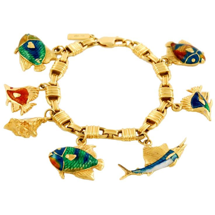 Gold and Enamel Charms Bracelet | From a unique collection of vintage charm bracelets at http://www.1stdibs.com/jewelry/bracelets/charm-bracelets/
