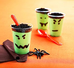 Vanilla pudding dyed green, topped with crushed oreos. Use small clear cups and a marker to make the faces.