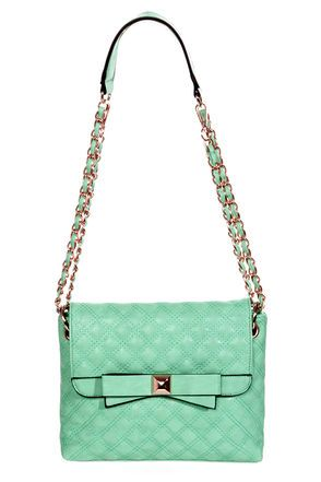 AS SEEN IN PEOPLE STYLEWATCH!! We know it's been a long run with your current handbag, but it's time to switch it up with the Seven Year Stitch Quilted Mint Purse! Smooth, mint green vegan leather is intricately top-stitched with aqua thread while the front fold-over flap gets embellished by a darling bow detail and shiny gold hardware. Lift magnetic snaps to reveal a secure zip-top and a printed lining with three interior pockets. Gold chain and vegan leather str...