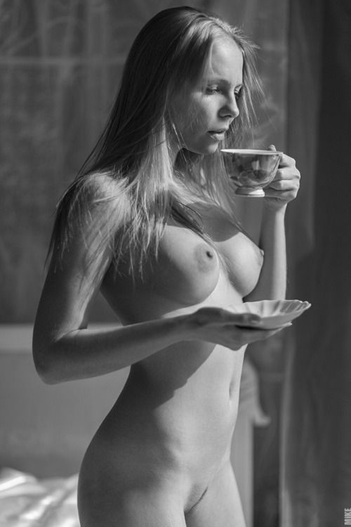 Naked woman drinking morning coffee information