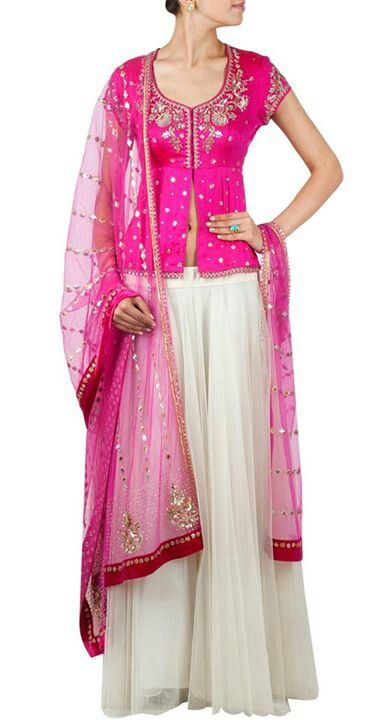 gorgeous lehenga - blouse by http://www.AnjuModi.com/--not lovin the slit in the blouse, but the colors are beautiful