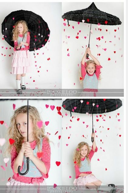 Stuck little hearts in the umbrella and then open it and take a picture as they fall out