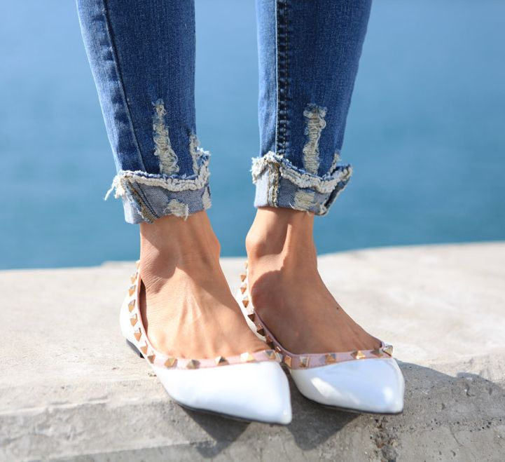 perfectly ripped cuffed jeans and Valentino rock studs.
