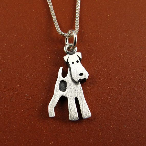 This frisky little wire fox terrier is made of brushed sterling silver. The pendant itself is about 5/8 tall, which means this is a TINY wire fox