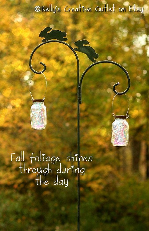 Mason Jar Solar Light fully assembled with a handle to hang it from.  No matter what season your garden is in, My solar lanterns will add amazing beauty to your landscape both day and night!