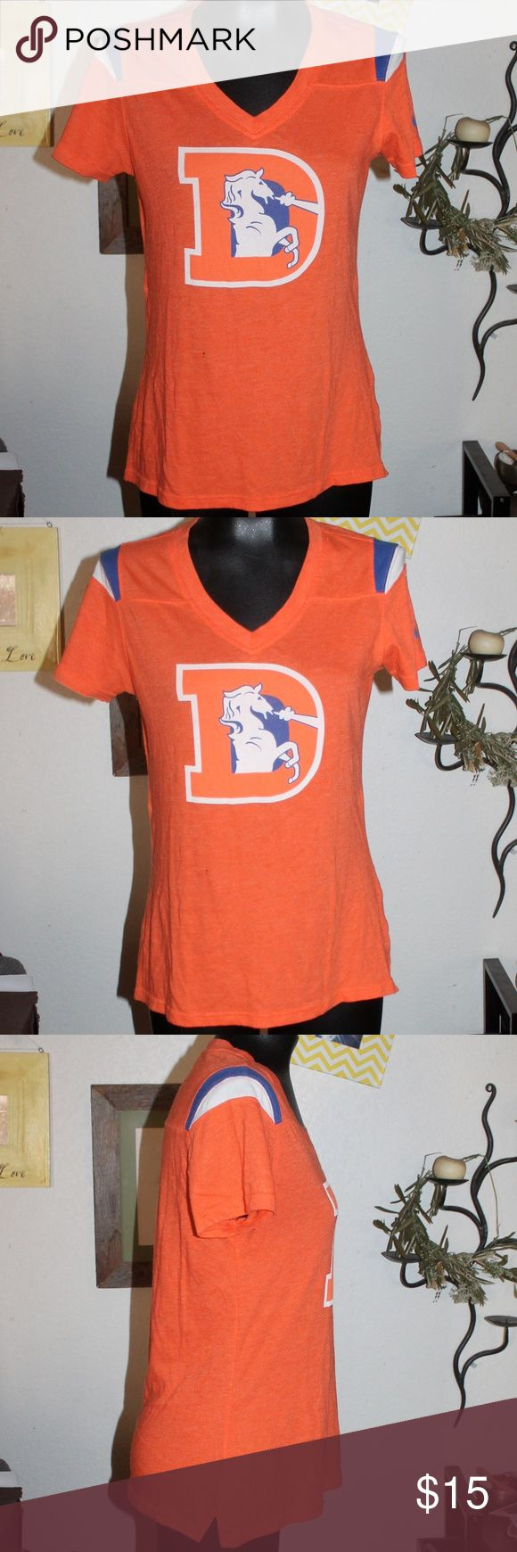 Nike NFL Team Apparel Denver Broncos V neck shirt Nike NFL Team Apparel  Denver Broncos  V neck shirt size M made in Vietnam RN#56323 CA#05553  60% cotton 40% polyester exclusive of decoration  FA130105BOV M 573274-827 659658405318  *one tiny little snag that i photographed next to a dime - very small and not noticeable :) Nike Tops