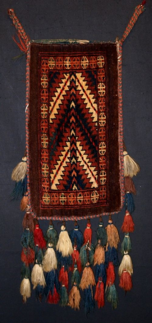 ANTIQUE YOMUT TURKMEN SPINDLE BAG, COMPLETE WITH TASSELS & BACK, CIRCA 1900