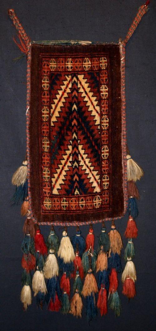 ANTIQUE YOMUT TURKMEN SPINDLE BAG, COMPLETE WITH TASSELS & BACK, CIRCA 1900