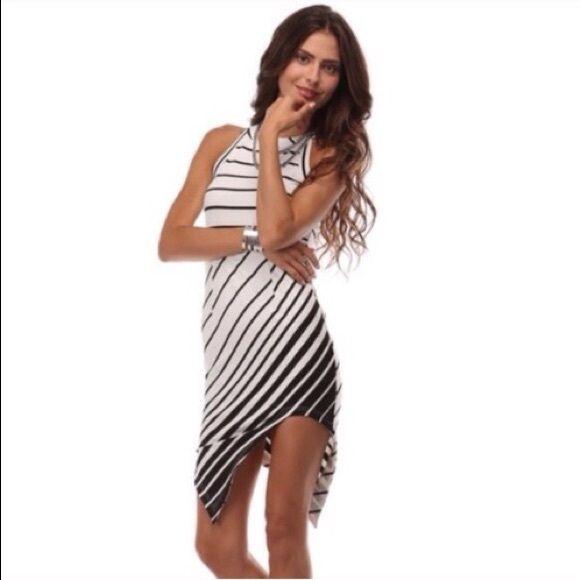 Asymmetrical Striped Dress Black and white asymmetrical dress by Tea & Cup. Sexy and casual dress. Tea n Cup Dresses Asymmetrical