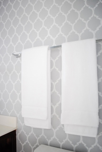 love the stenciled Wall add a punch of color with towels etc (coral, mint, purple)