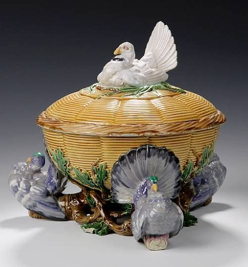A Minton Majolica tureen, cover and liner, dated 1862, the cover with nesting turkey final, the tureen supported by three coloured turkeys each perched on a branch