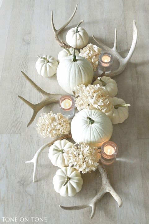 Go all in on the monochrome look for a totally classy (and somewhat unexpected) centerpiece. This sleek white grouping looks modern but still welcoming. Click through for the tutorial and more fall flower arrangements and centerpieces.