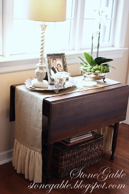 I love this little drop leaf table!  The runner looks great on it as well!
